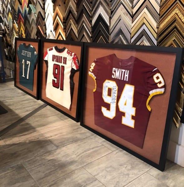 Super Bowl winning NFL jerseys custom framed with football inspired matboards